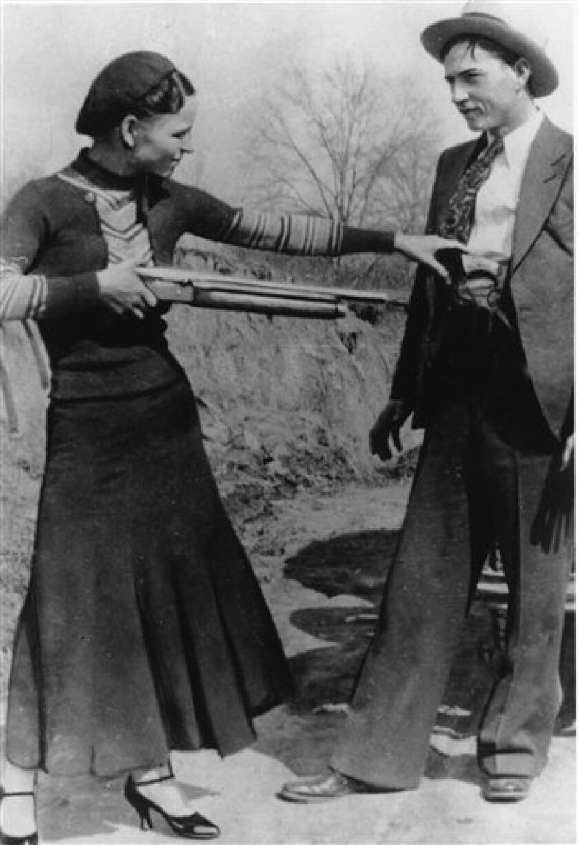 "In this undated file photo, notorious bandits Bonnie Parker, left, and Clyde Barrow are shown. A musical about the bank robbing lovers Bonnie Parker and Clyde Barrow is targeting Broadway. Producers said Thursday, June 23, 2011, ""Bonnie and Clyde,"" starring Laura Osnes and Jeremy Jordan will begin previews on Nov. 4 and open on Dec. 1 at the Gerald Schoenfeld Theatre in New York. (AP Photo/file)"