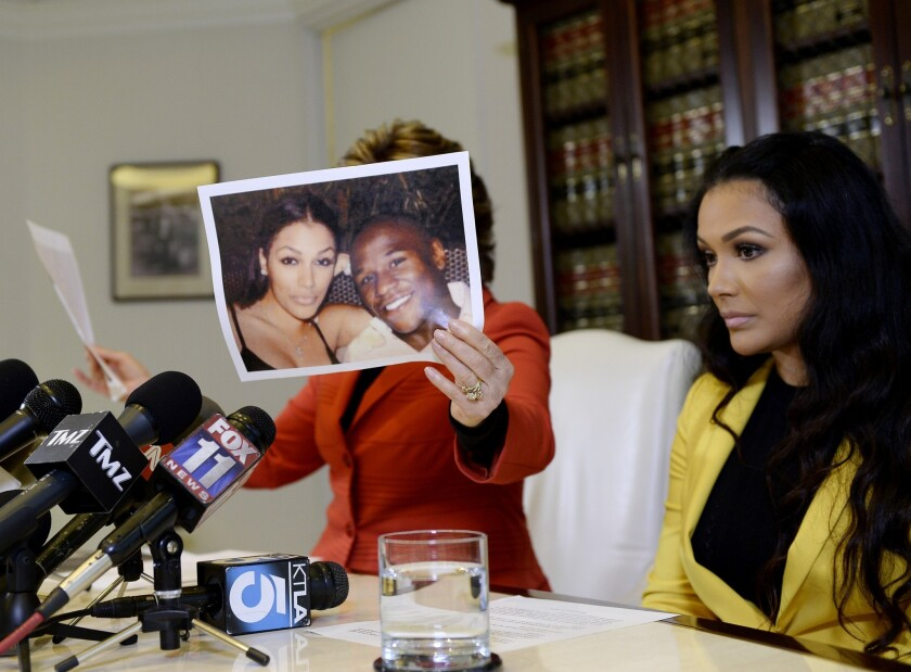 Floyd Mayweather Jr.'s ex-girlfriend Shantel Jackson, right, at a news conference after announcing a lawsuit against the boxer. Gloria Allred is her attorney.