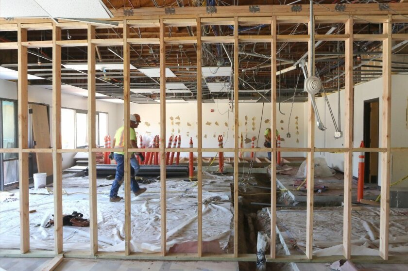 Construction workers upgrade a middle school in Escondido.