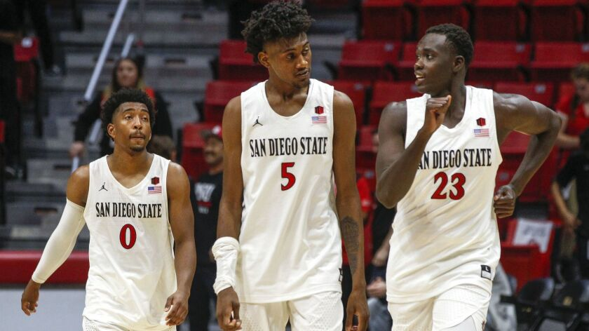 SAN DIEGO, November 1, 2018 | The Aztecs' Jalen McDaniels, center, Ed Chang, right, and Devin Watson