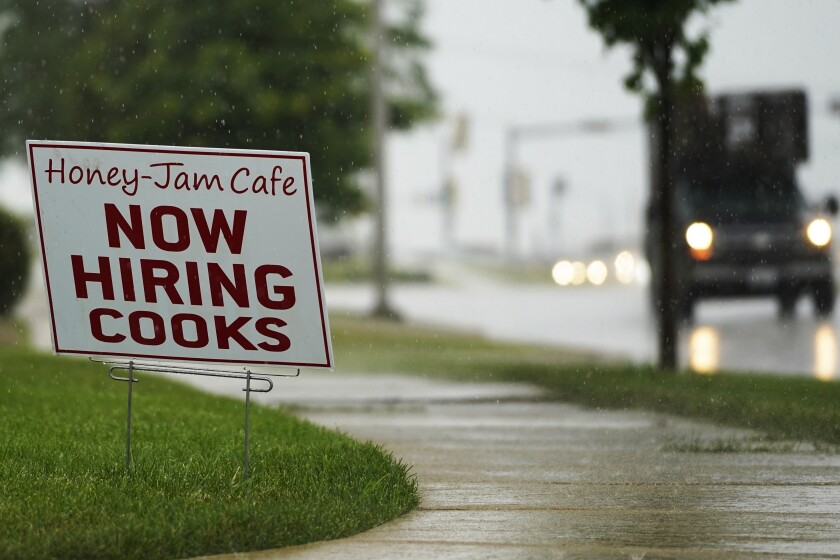 A hiring sign is shown in Downers Grove, Ill., on June 24.