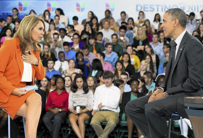President Obama participates in a town hall in 2012 hosted by Univision news anchor Maria Elena Salinas. The Spanish-language media company has two broadcast TV networks and more than 60 television stations