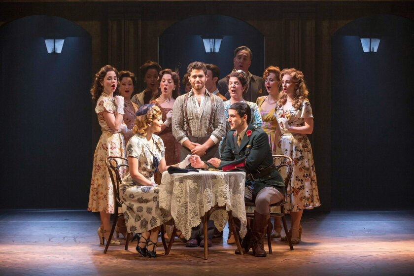 """Josh Lucas (standing, center) and the company of """"Evita."""""""
