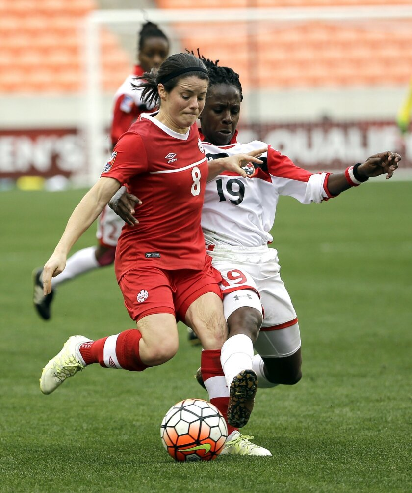 Trinidad & Tobago's Kennya Cordner (19) tries to steal the ball from Canada's Diana Matheson (8) during the first half of a CONCACAF Olympic qualifying tournament soccer match Sunday, Feb. 14, 2016, in Houston. (AP Photo/David J. Phillip)