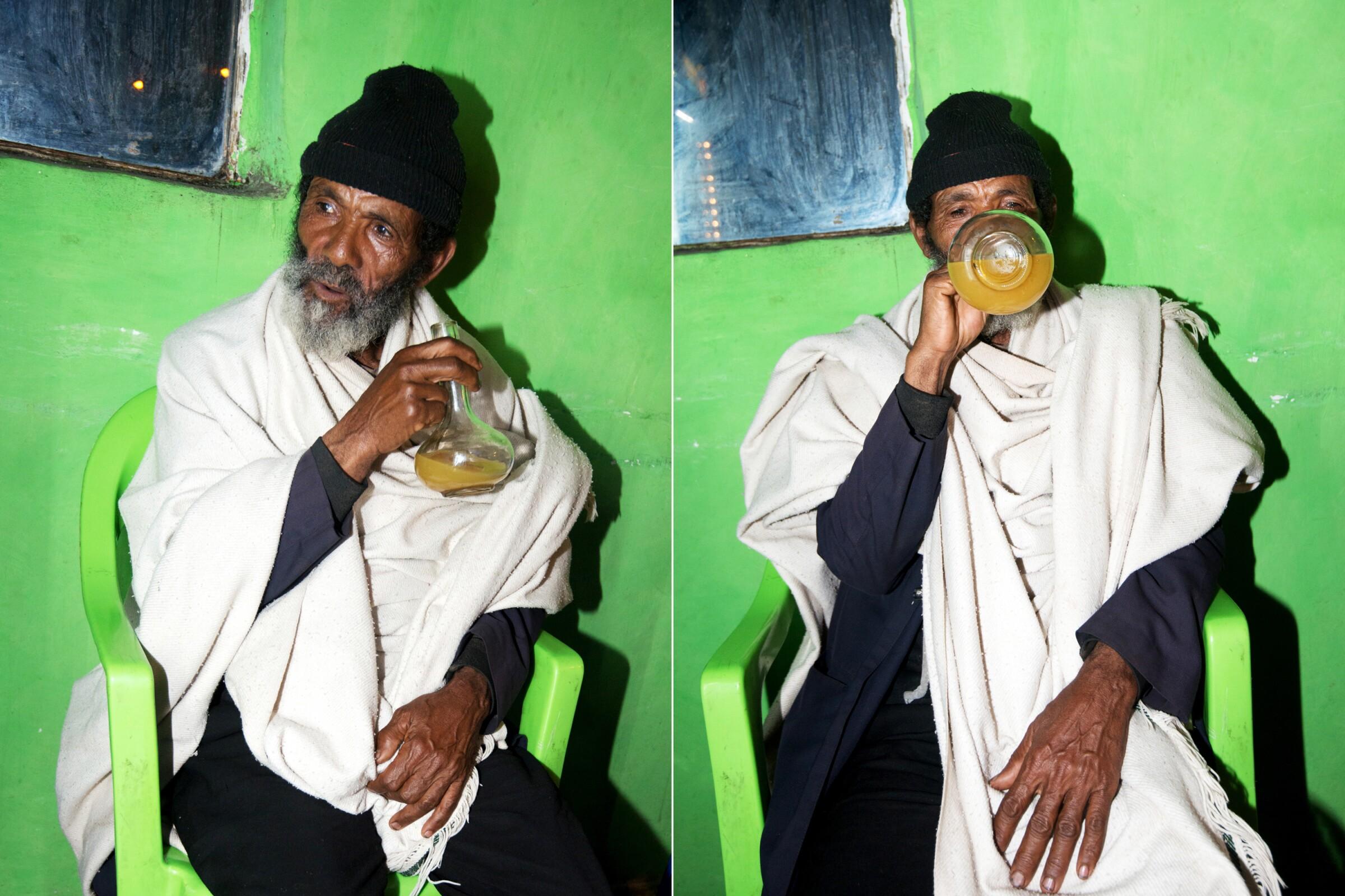 A patron enjoys a drink of tej bet