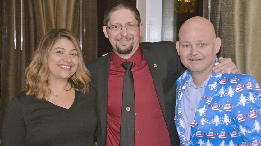Gregory Madore, center, who will serve as Burbank Rotary's 2019 president, ready for a festive eveni