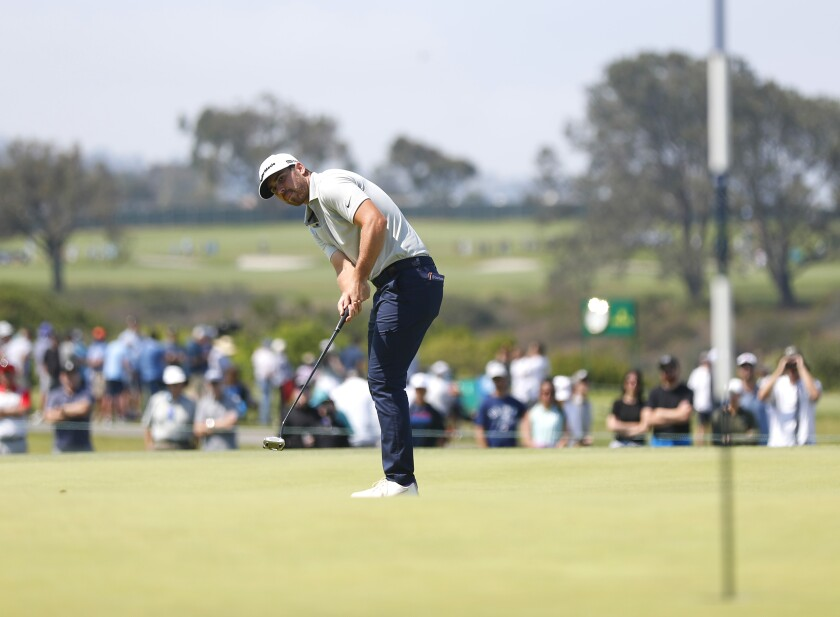 Matthew Wolff putts on the 15th hole