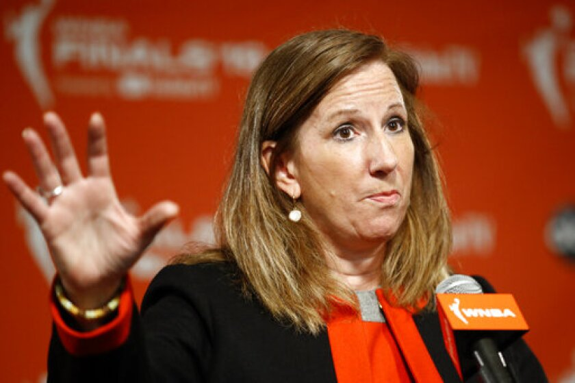 FILE - WNBA Commissioner Cathy Engelbert speaks at a news conference before Game 1 of basketball's WNBA Finals, in a Sunday, Sept. 29, 2019 file photo, in Washington. Atlanta Dream co-owner Kelly Loeffler is not in favor of the WNBA's social justice plans and has sent a letter to Commissioner Cathy Engelbert objecting to the league's initiatives to honor the Black Lives Matter movement when the season begins in Florida. Loeffler is a U.S. Republican senator running for re-election in Georgia.(AP Photo/Patrick Semansky)