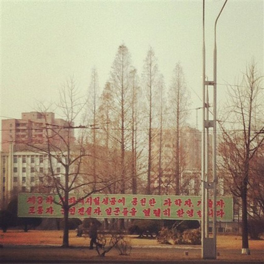 In this photo posted on Instagram, a man walks in Pyongyang, North Korea, under a new roadside banner referring to North Korea's controversial Feb. 12 nuclear test Monday, Feb. 25, 2013. Tweeting and uploading to Instagram is pretty ordinary stuff in the world of social media, but revolutionary for