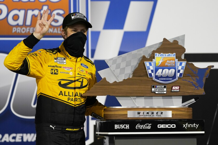 Brad Keselowski poses with the trophy as he celebrates winning a NASCAR Cup Series playoff race Sept. 12, 2020.