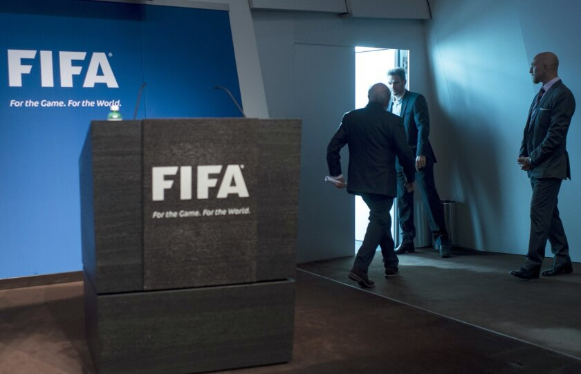 FIFA President Sepp Blatter leaves after speaking at a press conference at the FIFA headquarters in Zurich, Switzerland, Tuesday, June 2, 2015. Sepp Blatter says he will resign from his position amid corruption scandal and is promising to call for fresh elections to choose a successor. (Ennio Leanz