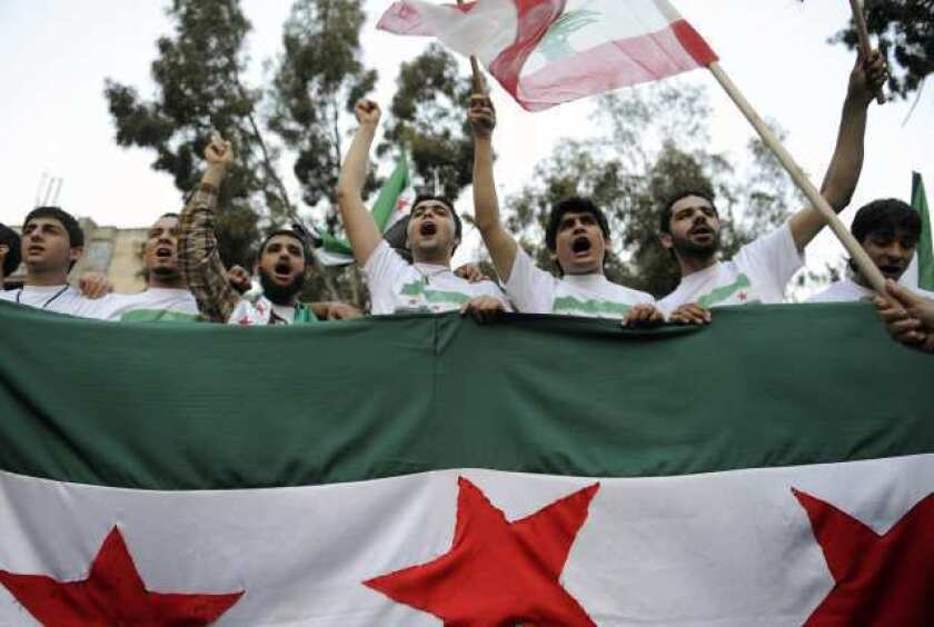 Syrians living in Lebanon shout slogans against Syrian President Bashar Assad during a rally in Beirut on April 28.