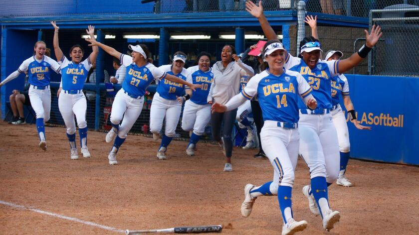 LOS ANGELES, CALIF. - MAY 25: The UCLA Bruins rush home plate to celebrate a home run by Taylor Pack