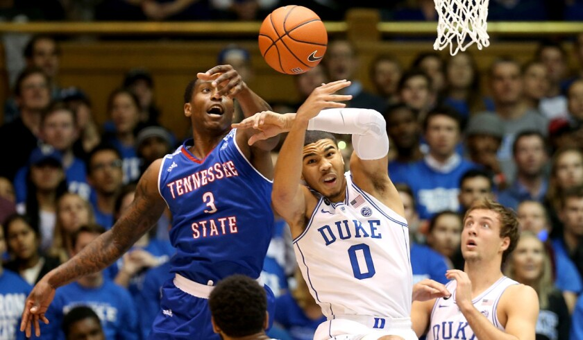 Tennessee State's Jordan Reed (3) goes after a loose ball against Duke's Jayson Tatum (0) during their game on Monday.