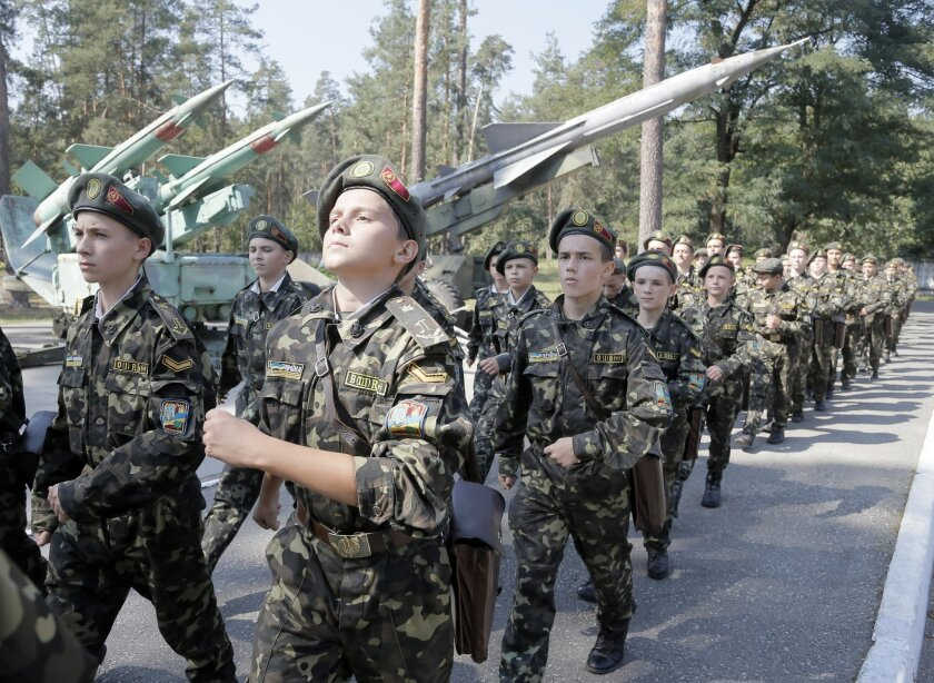 Students march during a military training exercise in a military school in Boyarka, near Kiev, Ukraine, in 2014.