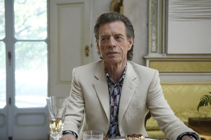 "This image released by Sony Pictures Classics shows Mick Jagger in a scene from the film, ""The Burnt Orange Heresy."" Jagger plays a devilish art collector who cunningly convinces an art journalist to use a rare interview with a reclusive artist as an opportunity to steal one of his paintings. It's Jagger's first film since 2001's ""The Man From Elysian Fields."" (Jose Haro/Sony Pictures Classics via AP)"