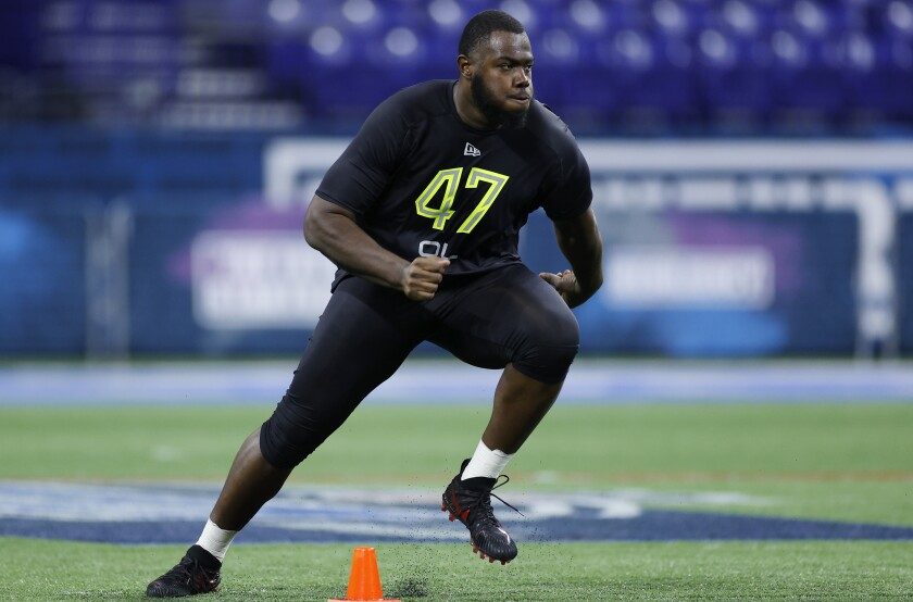 Georgia offensive tackle Andrew Thomas runs the cone drill at the NFL scouting combine.
