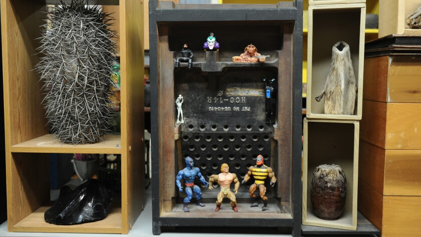 At center, an assemblage by Shiokava is crafted from an old machine mold and found toys.