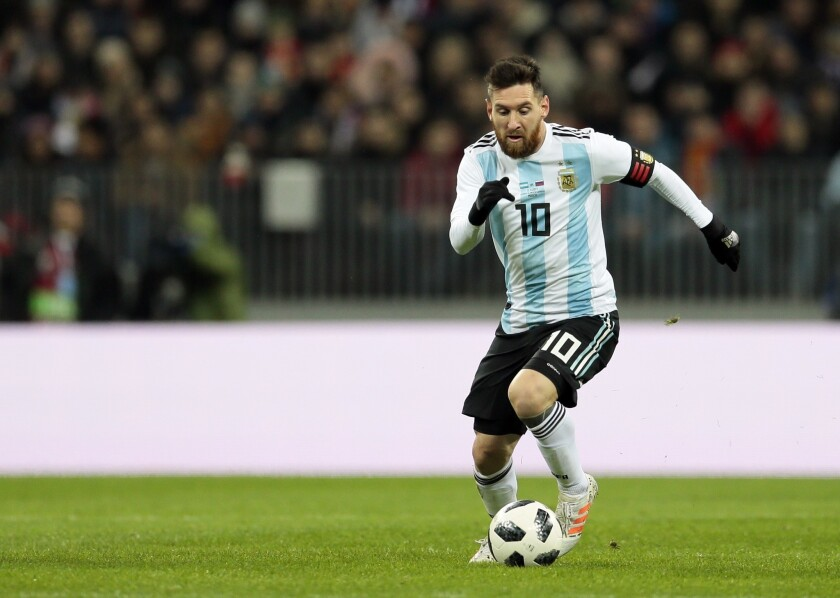 FILE - In this Saturday, Nov. 11, 2017 filer, Argentina's Lionel Messi controls the ball during the international friendly soccer match between Russia and Argentina at Luzhniki stadium in Moscow.