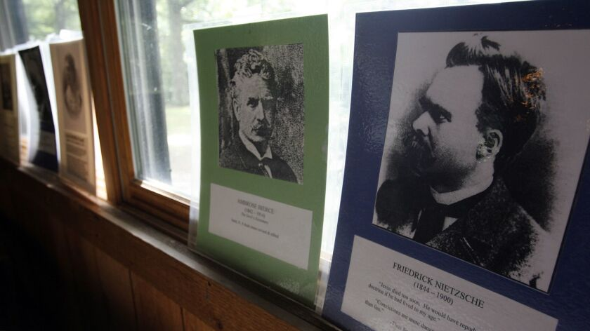 """A photo of Friedrick Nietzsche , along with other """"free thinkers"""" line the walls of the dining hall"""