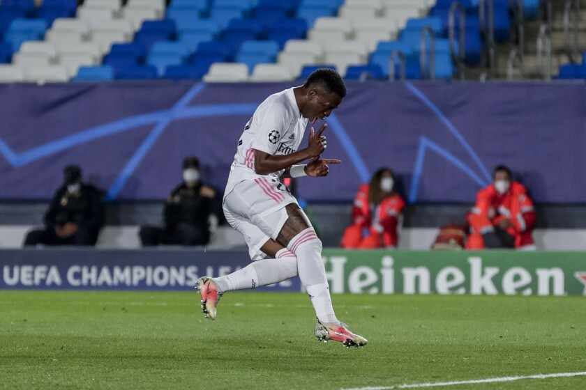 Real Madrid's Vinicius Junior celebrates after scoring his second goal during the Champions League quarterfinal first leg, soccer match between Real Madrid and Liverpool at the Alfredo di Stefano stadium in Madrid, Spain, Tuesday, April 6, 2021. (AP Photo/Manu Fernandez)