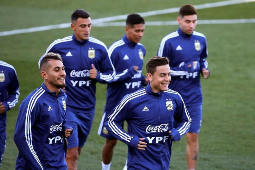 Argentina's national soccer team players Roberto Pereyra (L) and Paulo Dybala (R) participate in a training session at the Sports City of Real Madrid, in Madrid, Spain, 18 March 2019, before tomorrow's friendly match against Venezuela. EPA-EFE/ Kiko Huesca