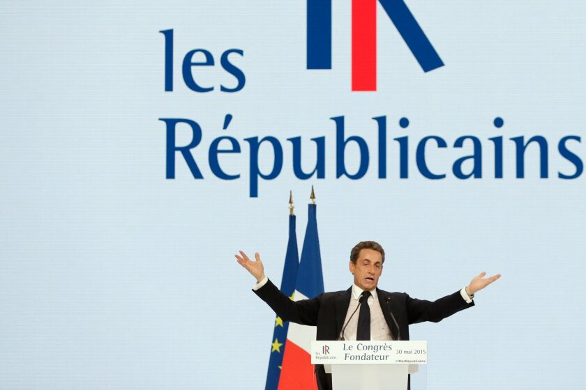 "Former French President Nicolas Sarkozy, leader of opposition right-wing party formerly known as the ""UMP"", delivers a speech during the party congress to mark the foundation of the movement ""Les Republicains"" (The Republicans), in Paris, Saturday, May 30, 2015. The UMP — an acronym for ""union for a popular movement"" — on Saturday officially changed its name to ""the Republicans"" after a two-day vote by members. The party, under the leadership of former French President Nicolas Sarkozy, is hoping that shedding its old name will also help unload some political baggage before the 2017 presidential race. (AP Photo/Thibault Camus)"