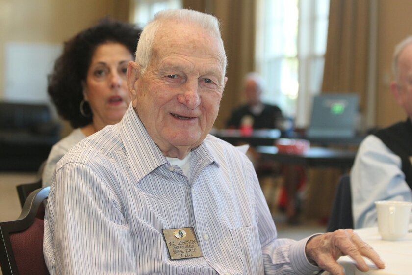 Former Kiwanis Club of La Jolla president Wil Johnson, celebrating his 85th birthday Jan. 23, placed an $85 check into the club's 'Happy Dollars' bucket during the lunch. Those who place one or more dollars in the bucket — used to fund club administration and special events — are given the floor to