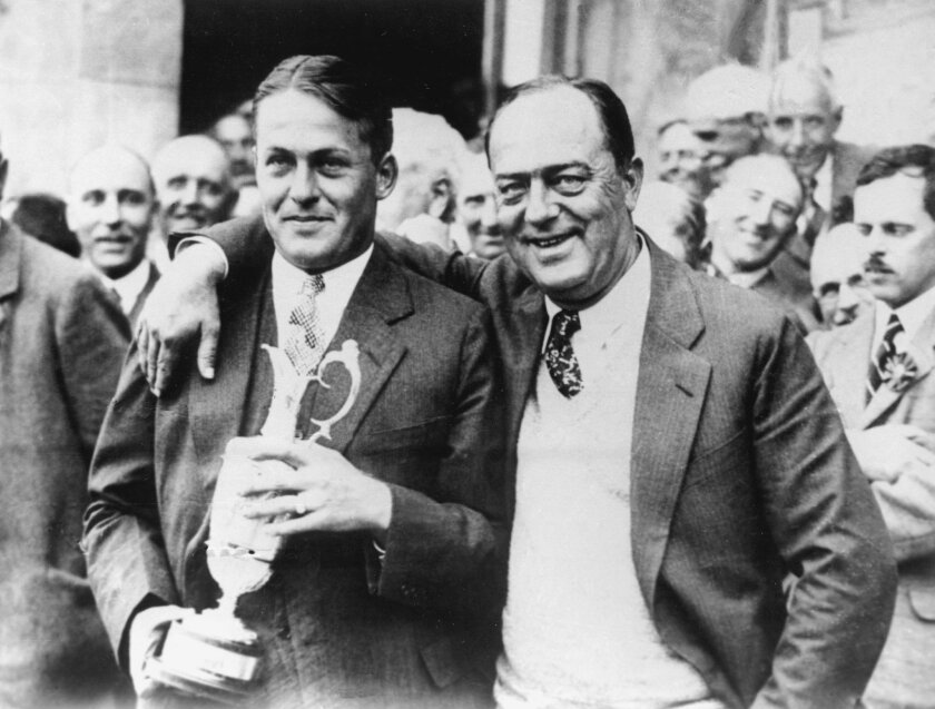 "FILE - In this July 22, 1927, file photo, American amateur Bobby Jones, left, poses with his father, Robert, after winning the British Open at St. Andrews, Scotland. Jones not only was the best amateur in U.S. Open history, he remains one of the greatest to ever play the game and is celebrated for his ""impregnable quadrilateral"" _ the Grand Slam _ by winning the U.S. Open, British Open, British Amateur and U.S. Amateur in 1930. (AP Photo/File)"