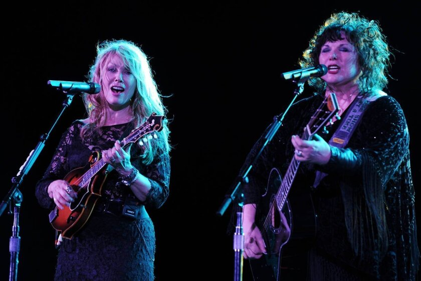 Nancy and Ann Wilson of Heart perform on opening night of the Heartbreaker Tour at the Cruzan Amphitheater June 17, 2013 in West Palm Beach, Florida.