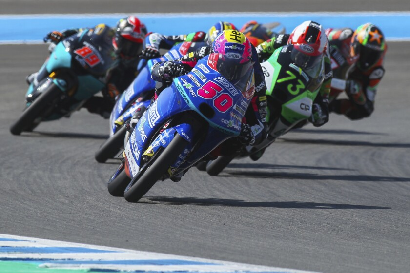 Swiss driver Jason Dupasquier, foreground, steers his motorbike during the Moto 3 race of the Spanish Motorcycle Grand Prix race at the Angel Nieto racetrack in Jerez de la Frontera, Spain, Sunday, July 19, 2020. (AP Photo/David Clares)