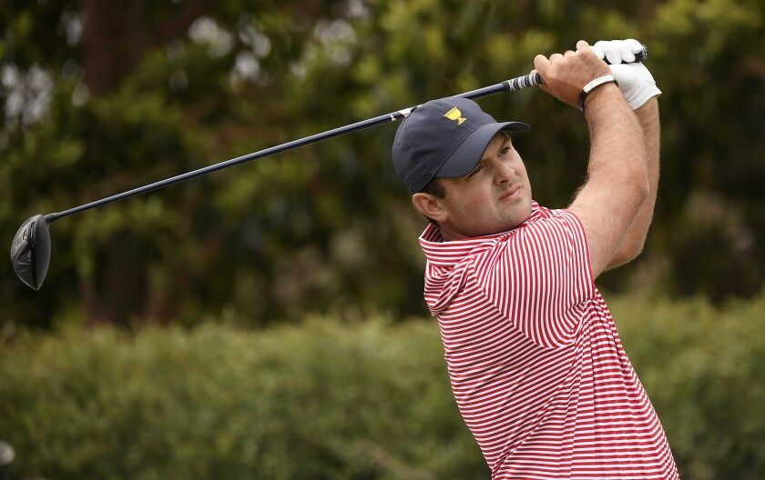 U.S. team player Patrick Reed tees off on the 9th hole during their fourball match at the Royal Melbourne Golf Club in the opening rounds of the President's Cup golf tournament in Melbourne, Thursday, Dec. 12, 2019. (AP Photo/Andy Brownbill)