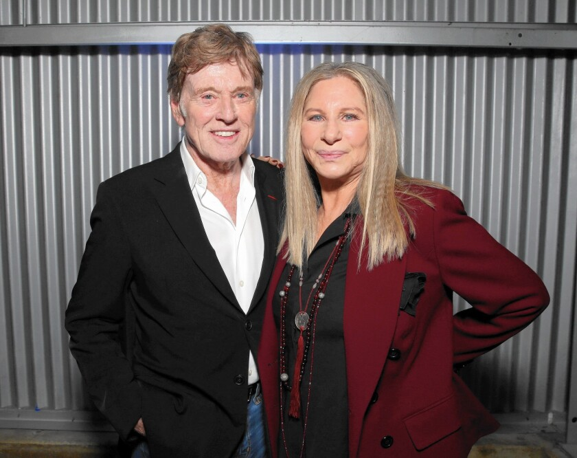 Robert Redford and Barbra Streisand attend the Hollywood Reporter's Women In Entertainment Breakfast