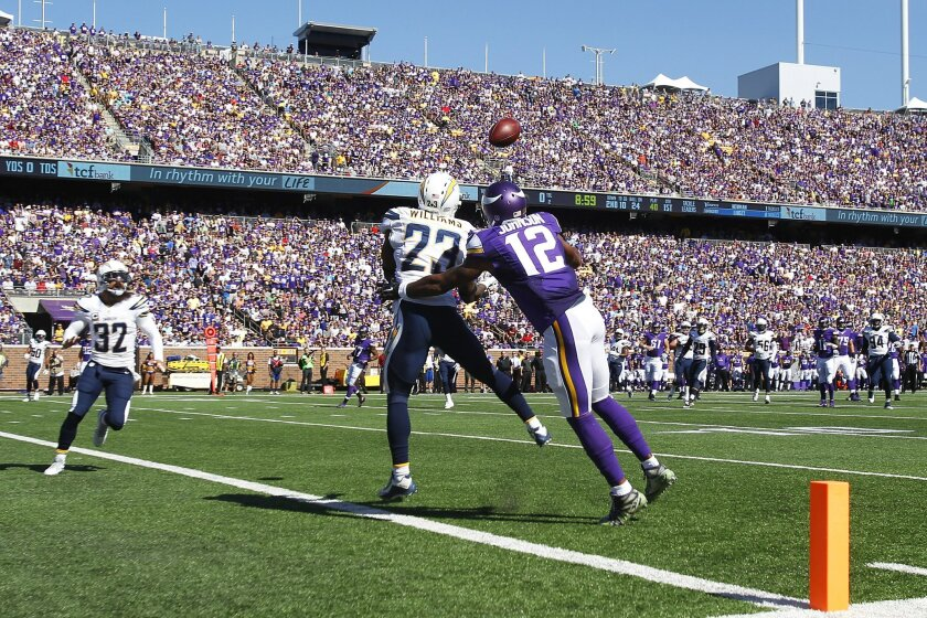 Chargers Steve Williams (23) intercepts a pass intended for Vikings Charles Johnson in the 1st quarter.