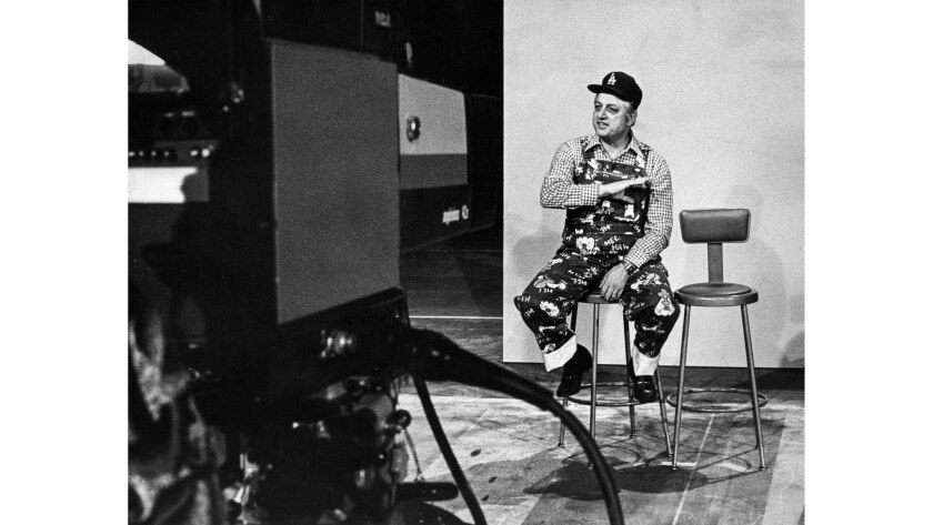 """Los Angeles Dodgers manager Tommy Lasorda taping a segment for """"Hee Haw"""" in 1977."""