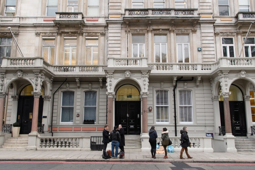 Journalists gather outside the London headquarters of Orbis Business Intelligence, the company run by British former intelligence officer Christopher Steele.