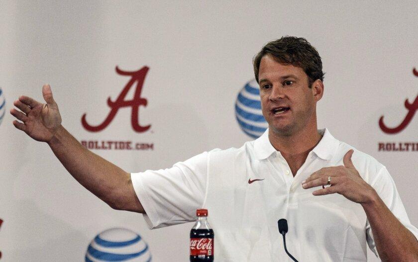 Alabama NCAA college offensive coordinator/quarterbacks coach Lane Kiffin speaks to the media before practice Sunday, Aug. 3, 2014, in Tuscaloosa, Ala. (AP Photo/AL.com, Vasha Hunt) MAGS OUT