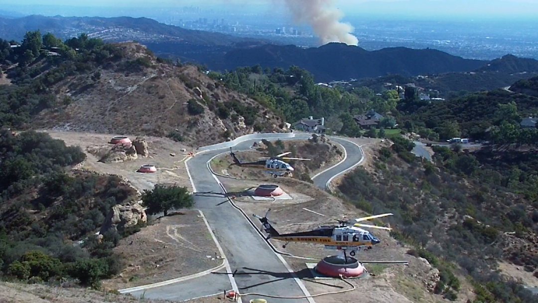 Los Angeles County Fire Department helicopter refilling with water during the Palisades Fire on Oct. 21.