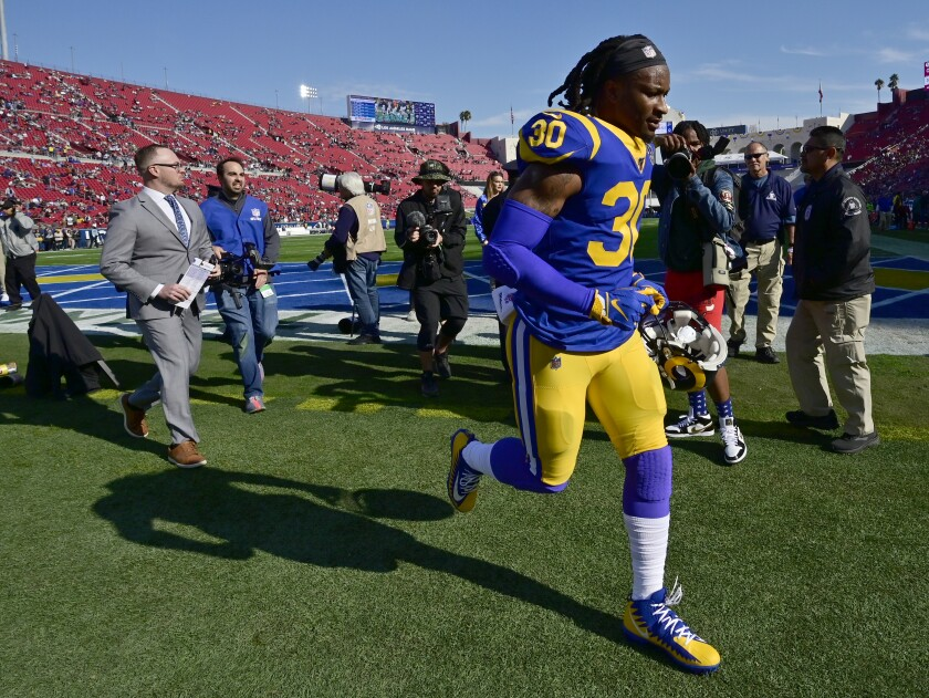 Todd Gurley runs off the field following the Rams' season finale against the Cardinals on Dec. 29. 2019, at the Coliseum.