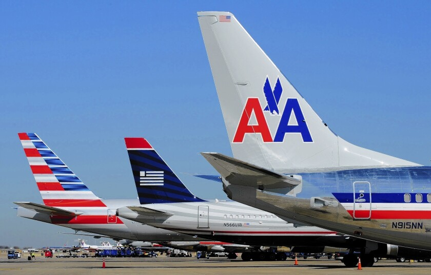 The latest major airline merger was approved last month when American Airlines agreed to unite with US Airways to create the world's largest carrier. Above, planes at Dallas/Fort Worth International Airport last year.