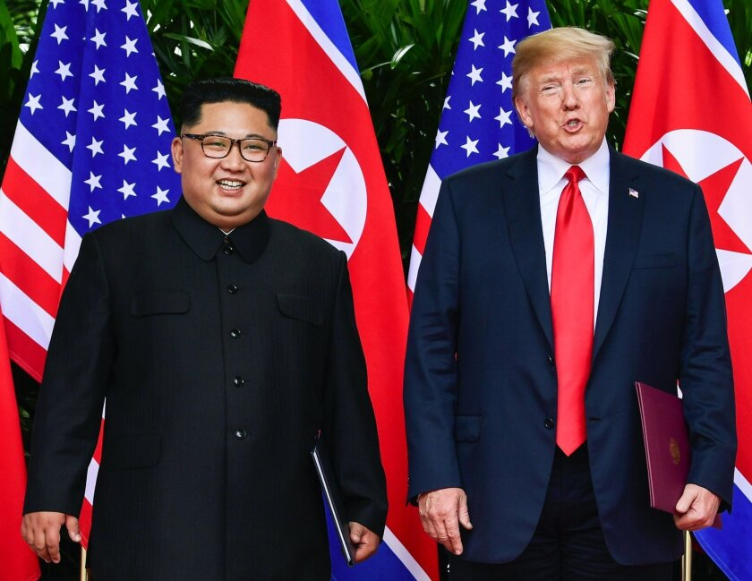 North Korea leader Kim Jong Un and President Trump stand side by side before their departures after meeting at the Capella resort in Singapore on June 12.