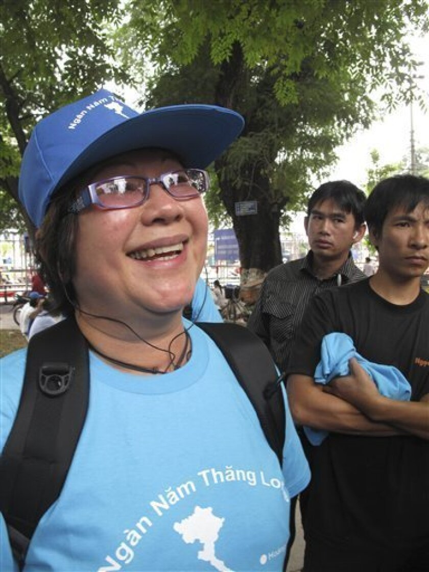 In this Saturday, Oct. 9, 2010, photo Hong Vo, a 53-year-old social worker from Melbourne, Australia, participates in a rare public protest in Hanoi, Vietnam. Vo, detained by police on Sunday, Oct. 10, is a member of the banned U.S.-based pro-democracy group, Viet Tan, or Vietnam Reform Party. (AP Photo)