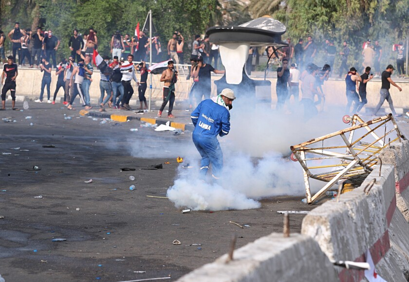Iraqi security forces fire tear gas during a protest in Tahrir Square, in central Baghdad, Iraq, Tuesday, Oct. 1, 2019. Iraqi security forces fired tear gas on hundreds of protesters in the Iraqi capital who were demonstrating against corruption and bad public services. (AP Photo/Khalid Mohammed)