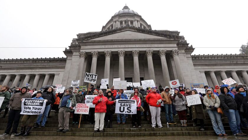 Protesters chant on the steps of the Washington statehouse on Monday in Olympia.