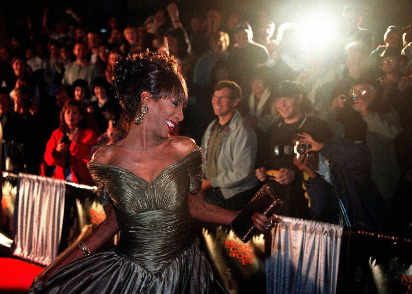 """The Lady Chablis twirls for the crowd awaiting the stars of the movie """"Midnight in the Garden of Good and Evil"""" to arrive for the premiere screening in Savannah, Ga., in 1997."""
