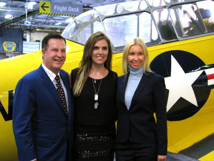 """""""Papa"""" Doug Manchester, Taya Kyle, Geniya Manchester at the """"American Wife"""" book launch at the USS Midway Museum. Photo by Jeanne McKinney"""