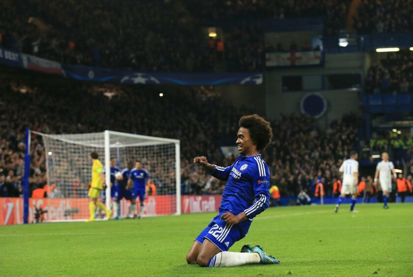 Chelsea's Willian celebrates after scoring the winning goal during the Champions League Group G soccer match between Chelsea and Dynamo Kiev at Stamford Bridge Stadium in London,  Wednesday, Nov. 4, 2015. (AP Photo/Tim Ireland)