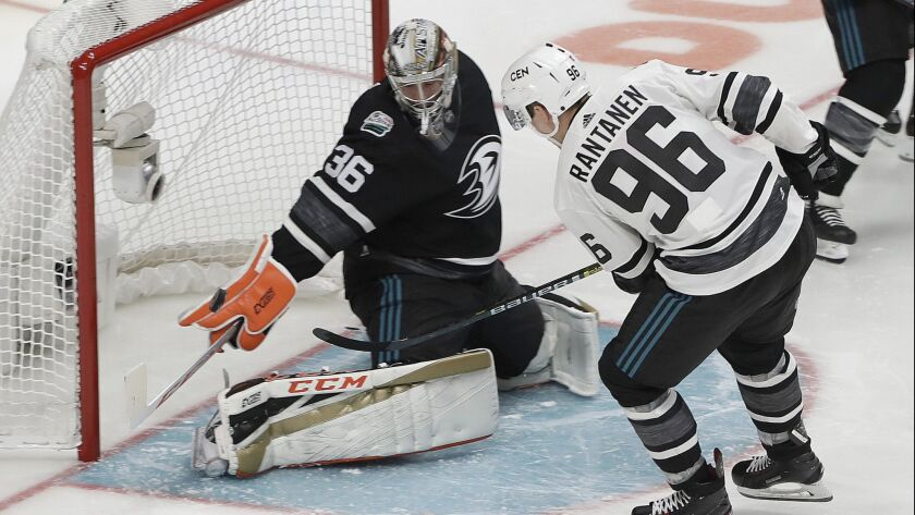 Central Division's Mikko Rantanen (96) scores a goal against Pacific Division's John Gibson during the NHL All-Star Game in San Jose on Saturday.