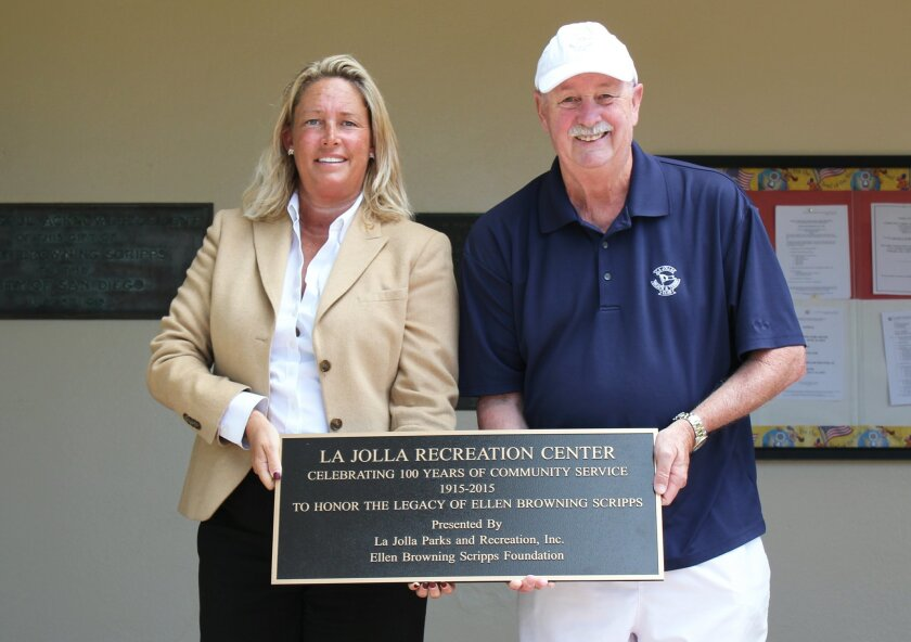 La Jolla Parks and Recreation, Inc. vice-president Cindy Greatrex and president Douglas Fitzgerald display a new plaque commemorating the 100-year anniversary of La Jolla Recreation Center.