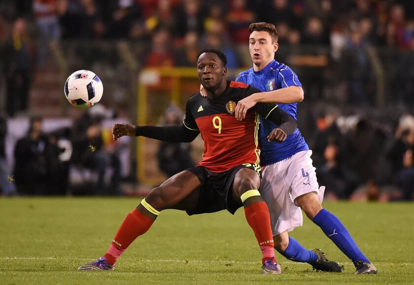 FILE - In this Friday, Nov. 13, 2015 file photo, Belgium's Christian Benteke, left, challenges for the ball with Italy's Matteo Darmian during a friendly soccer match at the King Baudouin stadium in Brussels. The European Championship has a reputation for being the soccer fans' favorite tournament